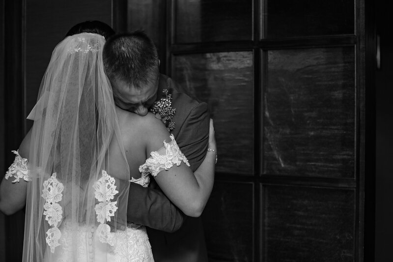 Father hugs bride and cries at Sheraton Bayfront Hotel wedding in Erie, PA