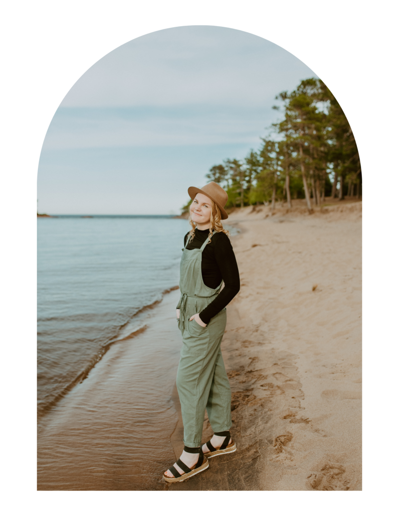 girl standing on the shore of lake superior during senior session