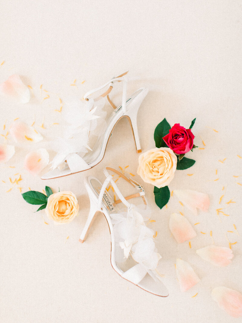 Badgley Mischka Wedding shoes and roses on Heirloom bindery styling board