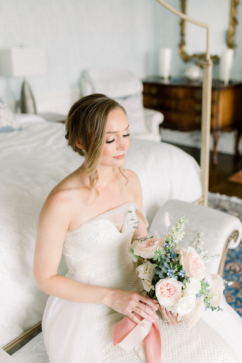 Richmond wedding photographer, bride sitting with her eyes closed holding wedding bouquet
