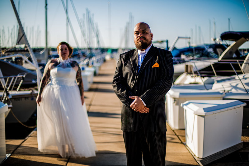 Bride watches her groom on the transient docks at the Erie Yacht Club