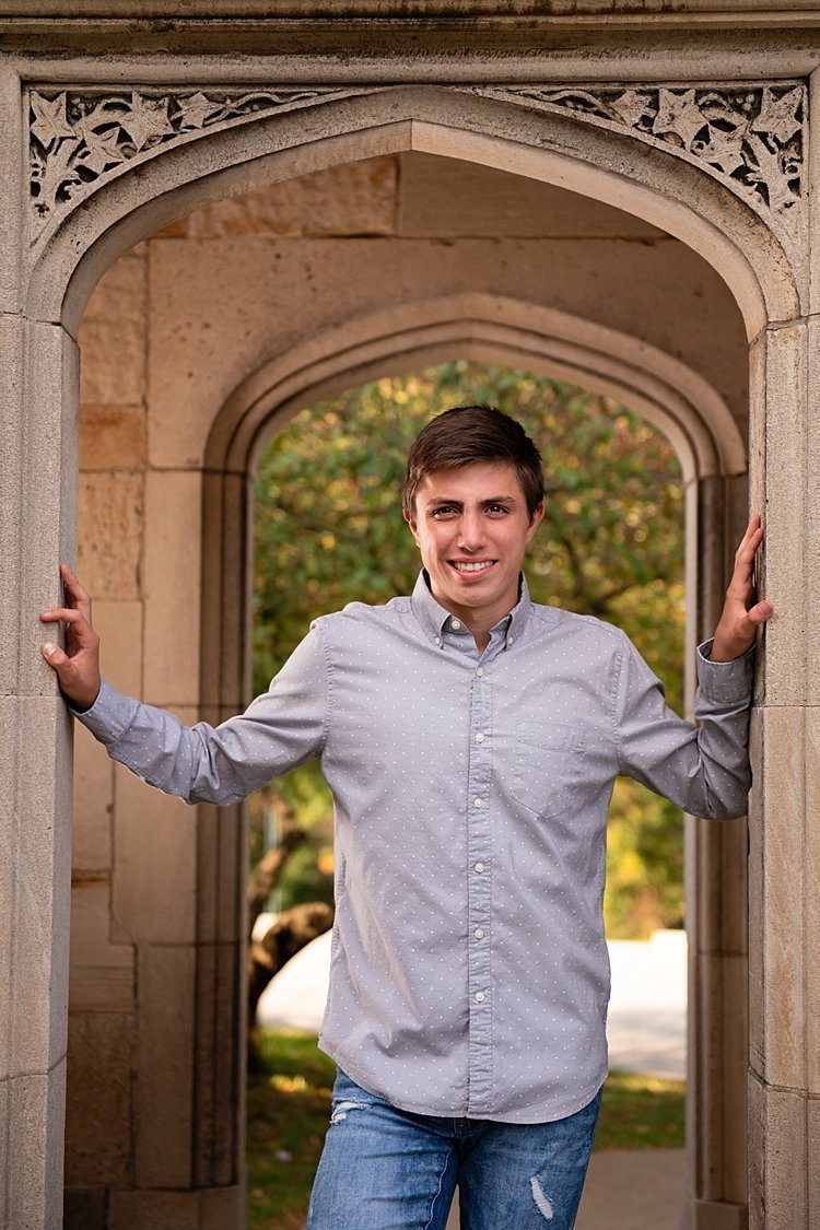 High school senior boy standing in archway of mansion at Hartwood Acres in Pittsburgh, PA