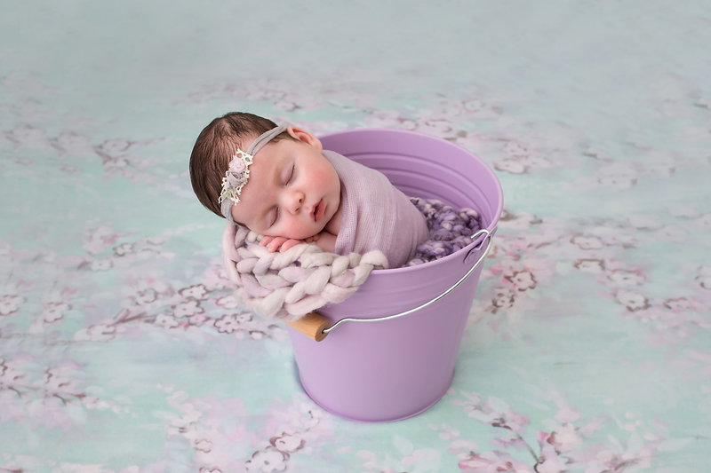 newborn in bucket