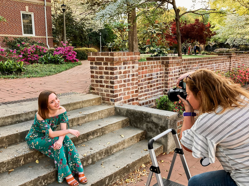 A photographer taking senior portraits on the campus of USC in Columbia SC
