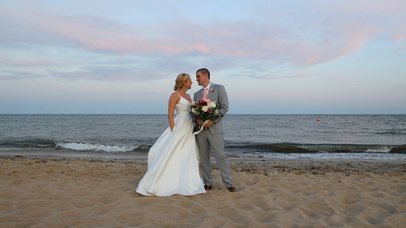 Bride and groom smiling on the beach at Popponesset Wedding on Beach
