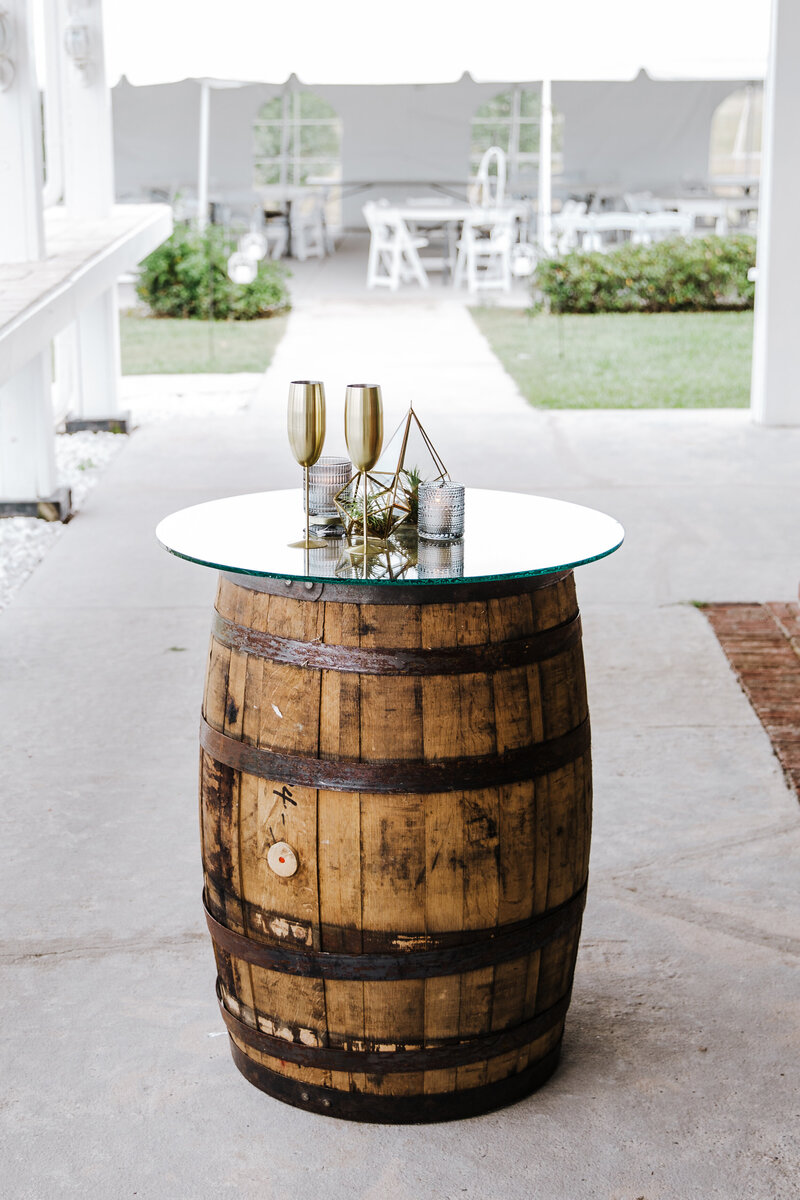Geometric Centerpieces and Votives on Rental Barrel