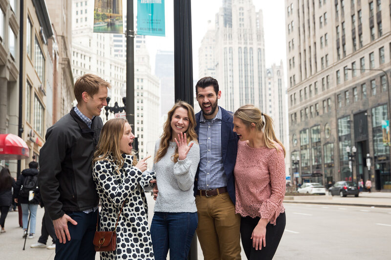 friends looking at engagement ring woman gasping from surprise engagement downtown chicago mag mile
