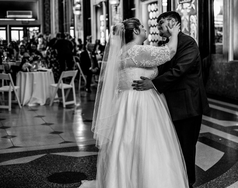 Bride touches groom's cheek during first dance at Warner Theatre wedding reception