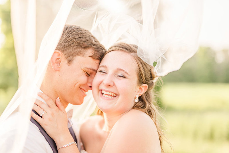 bride-giggling-with-her-groom