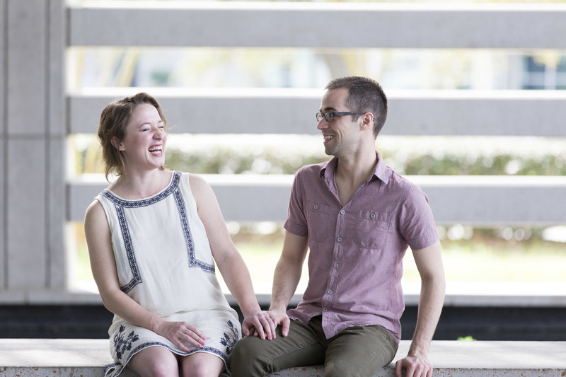 Couple laughs and smiles during their Capitol Park in Baton Rouge Engagement Session