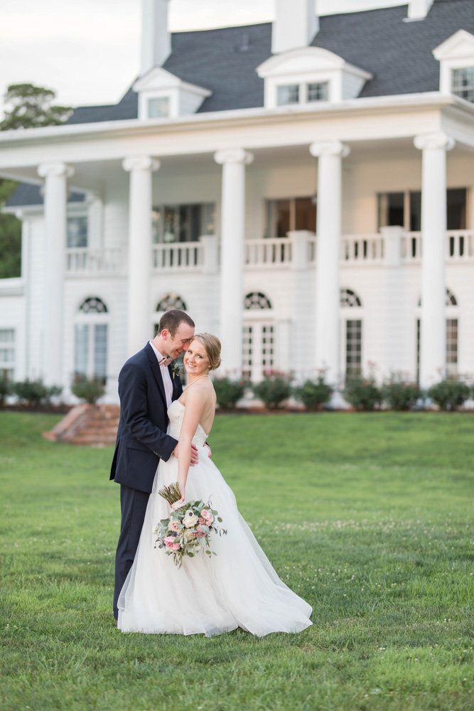 bride and groom in front of manor at eastern shore wedding at kirkland manor by costola photography