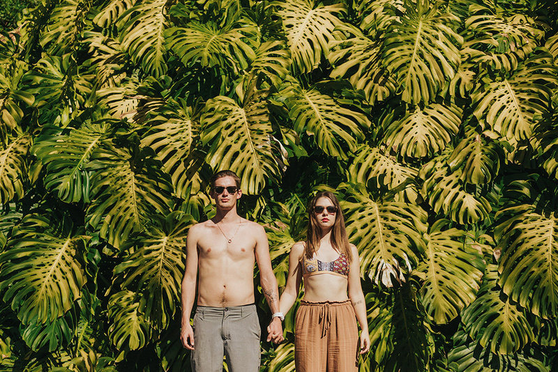Tropical leaves and cool couple