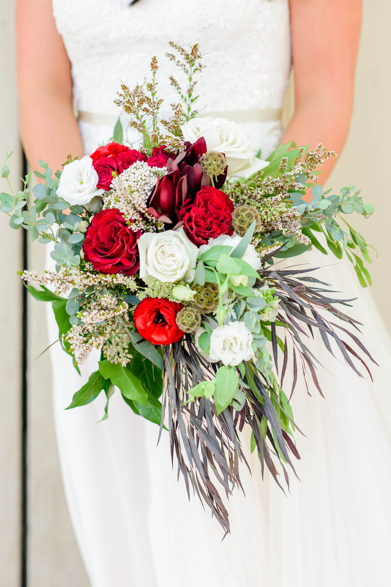 Organic bridal bouquet with Maroon, white, and green florals