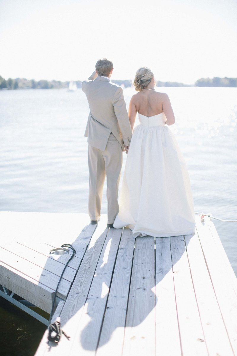 Lake Wawasee wedding couple on a pier in Syracuse indiana