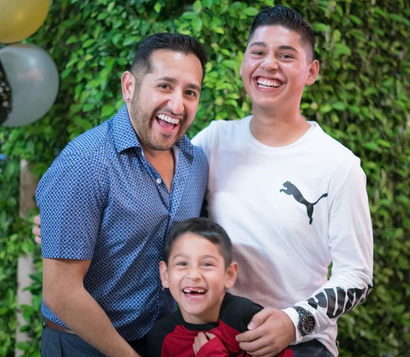 Laughing family after being tickled at birthday party