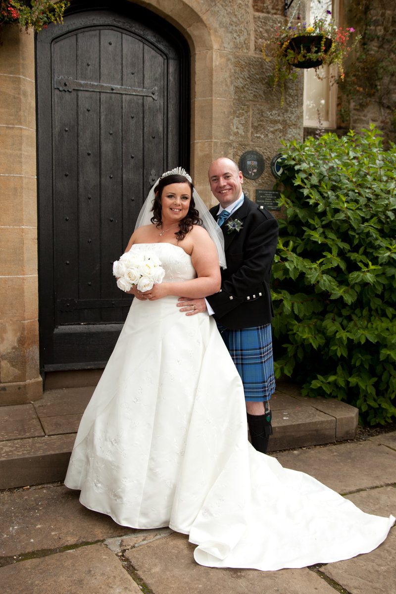 Bride and groom full length portrait at Dean Castle park