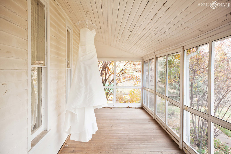 Wedding-Dress-on-Covered-Patio-at-Denver-Botanic-Gardens-Chatfield-Farms