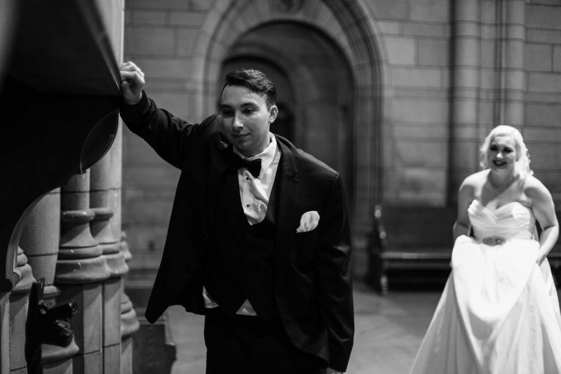 Bride sneaks up on groom for first look portrait at Cathedral of Learning in Pittsburgh, PA
