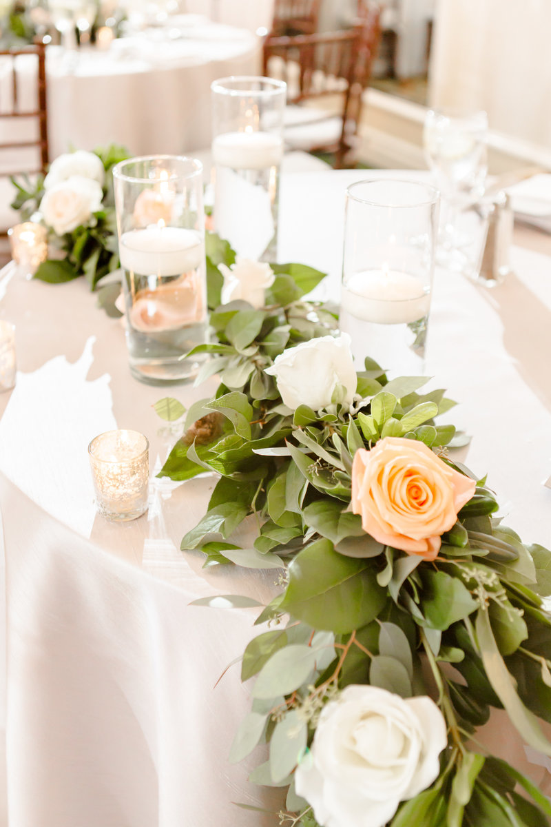 Floral garland on sweetheart table