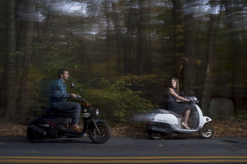 Couples riding motorcycles on country road