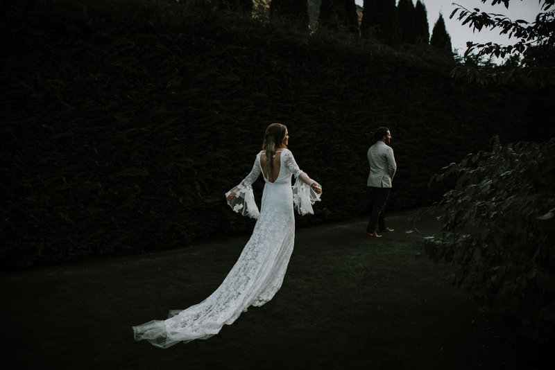 Bride and groom walking in garden