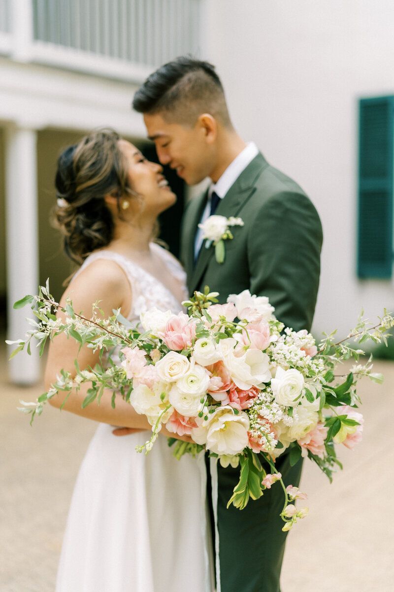 bride and groom with spring bouquet