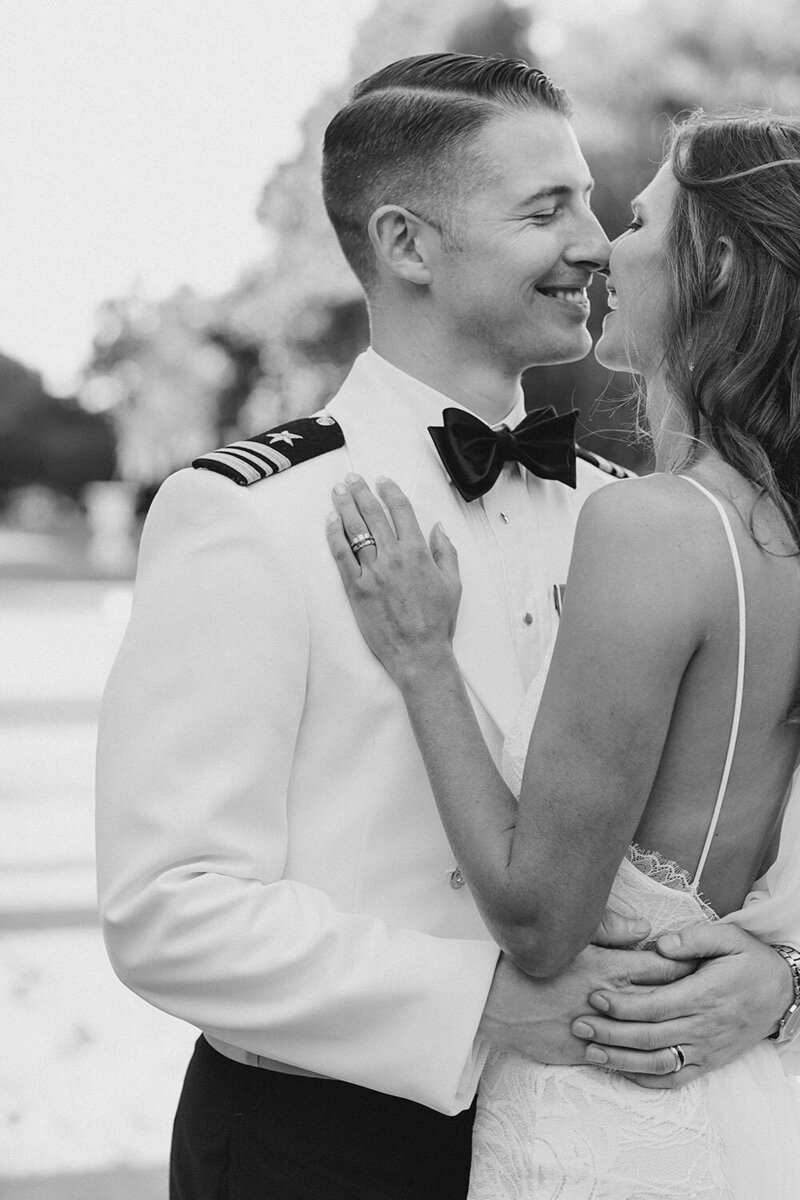 Black and white bride and groom portrait with groom in US navy formal dress