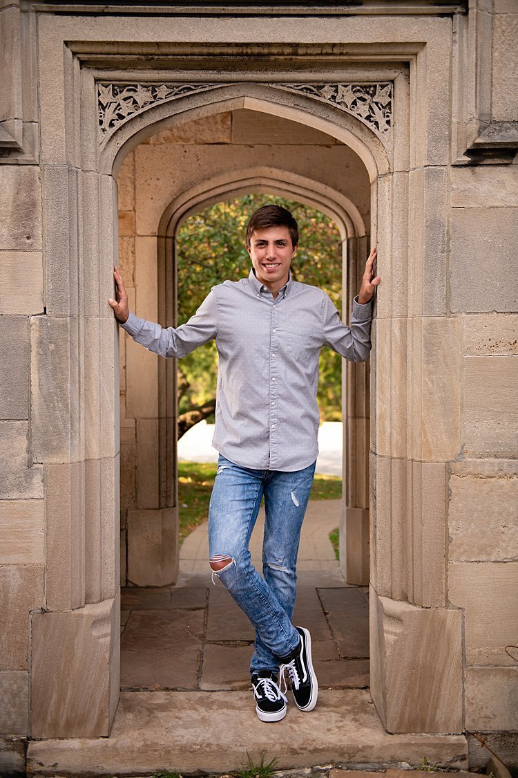 High school senior boy standing in archway at Hartwood Acres in Pittsburgh, PA