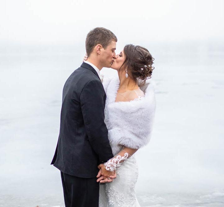 Brides who want a winter wedding always make us smile.  Snow falling around them and arms around each other keeping warm, it is a wonderful sight.