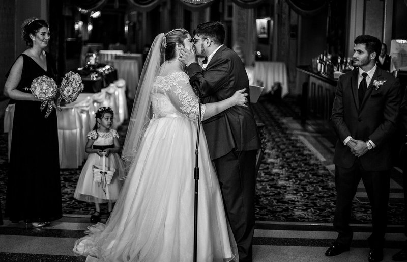First kiss at the end of Warner Theatre wedding ceremony