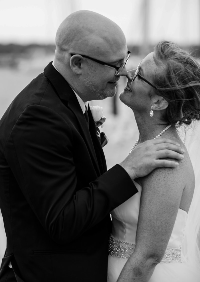 Couple smiling during bridal portraits at Erie  Yacht Club