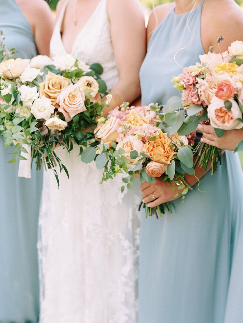 Blue and Peach Bridesmaids with Bouquets