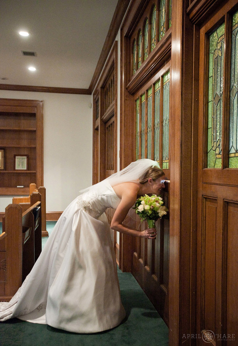 Bride looks out of the historic doorway at Central Presbyterian Church