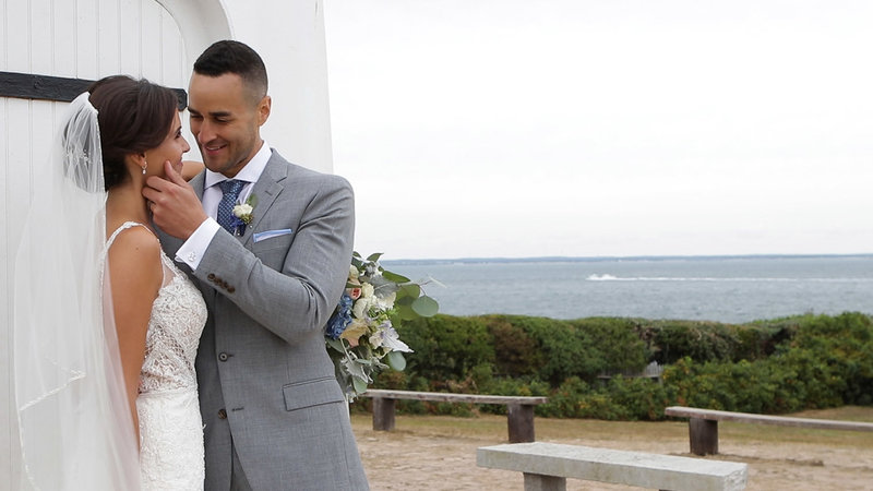 Bride and groom smiling at each other at martha's vineyard lighthouse wedding