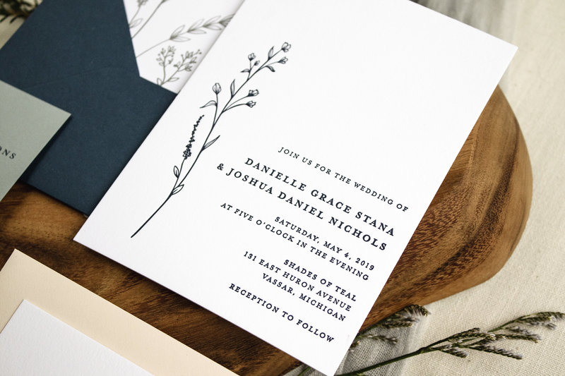 Close up of Brittney Nichole Designs Modern Wildflower wedding invitation showing beautiful details of the letterpress