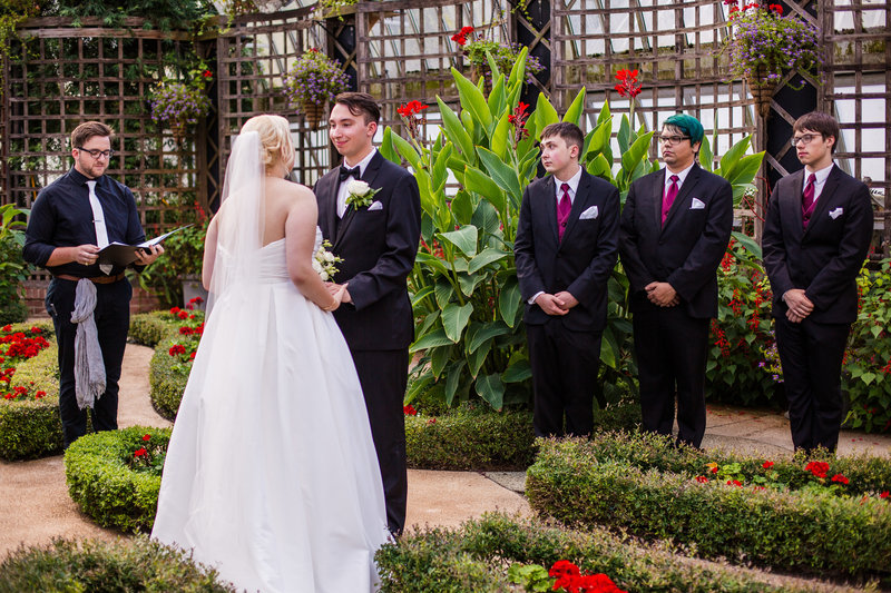 Bride and groom exchange vows at Phipps Conservatory wedding