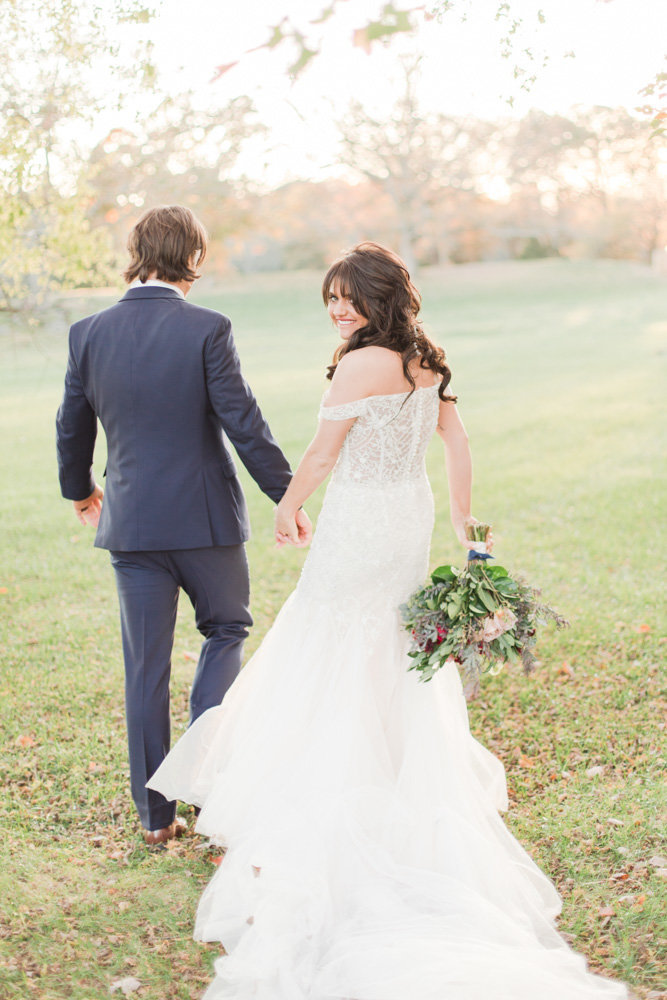 couple walking to reception at great marsh estate wedding in northern virginia by costola photography