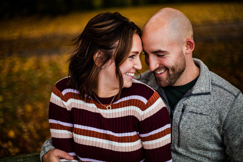 Smiling couple during engagement photos at Lake Erie Community Park in Girard PA