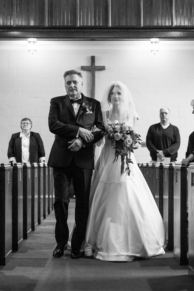 dad walking bride up the aisle at trinity lutheran church port huron