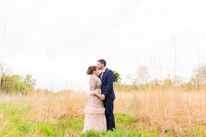 Bride and Groom Portrait in wild field | Megan Snitker Photography | Iowa City Wedding Photographers