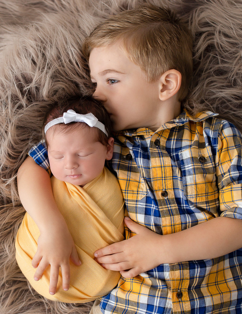 Big brother with newborn sister in our Rochester NY studio.