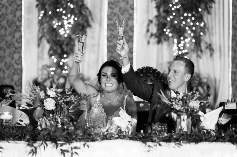 bride and groom toasting at a wedding reception
