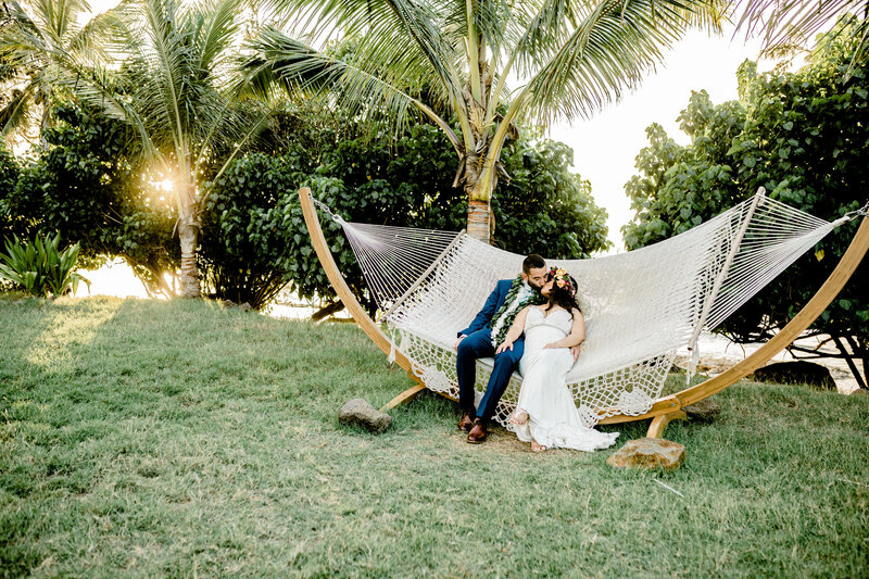 bride and groom on hammock family formals at loulu palm in hawaii