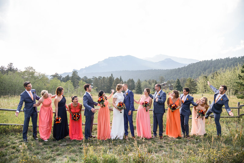 Bridesmaids and groomsmen surrounding bride and groom in Estes Park, Colorado
