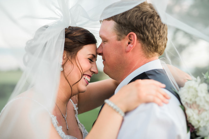 Red Deer Photographers-Raelene Schulmeister Photography- wedding photos-Cathedral length veil-Coronation, AB outdoor wedding ceremony