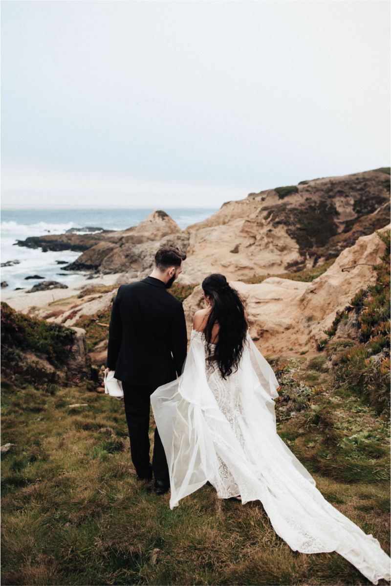 bride-and-groom-walking-down-to-shore