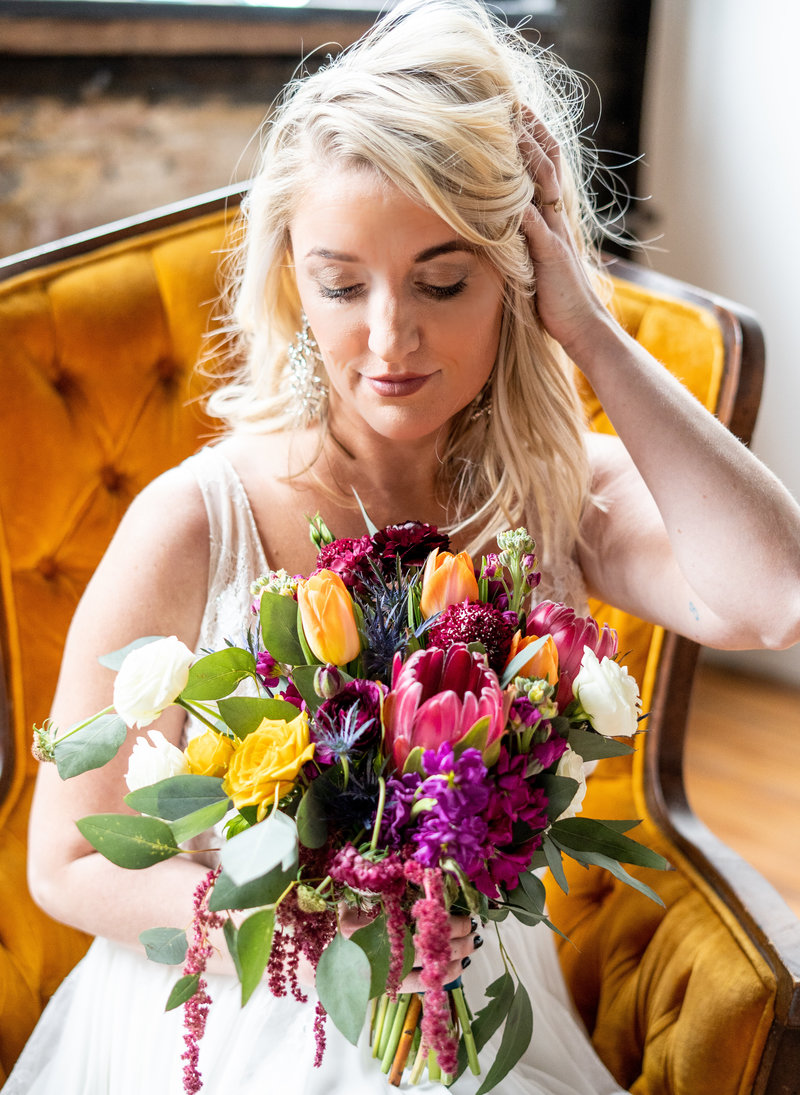 Bride with bright bold bouquet for her industrial venue in Cincinnati