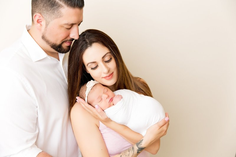 Family pose with newborn