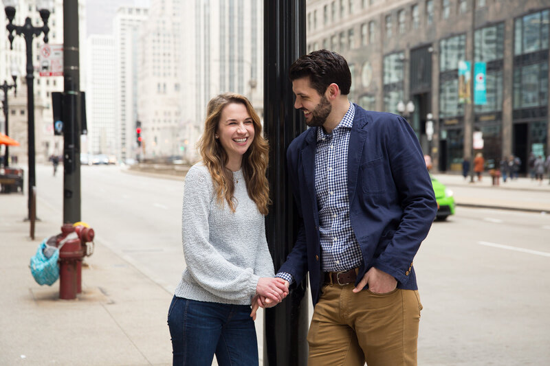 couple smiling at each other after proposal