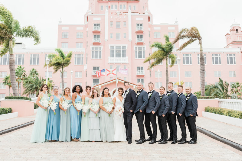 wedding party in front of historic hotel at Don Cesar Wedding Photographer in St. Petersburgh Florida by Costola Photography